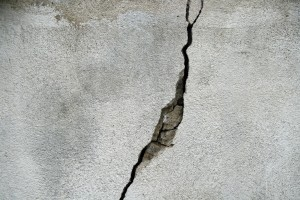 Cracks in building materials allow moisture to work its way inside, leading to progressively worse problems as the weather changes.